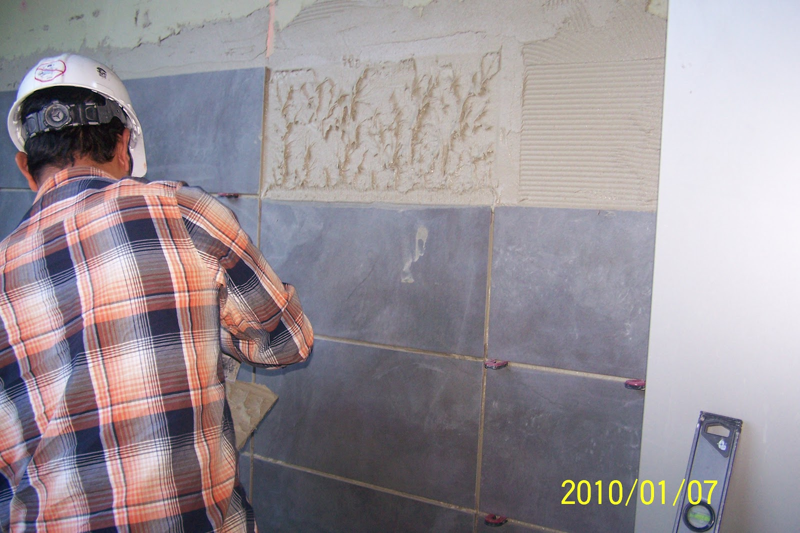 Man working on tile installation project as a contractor.