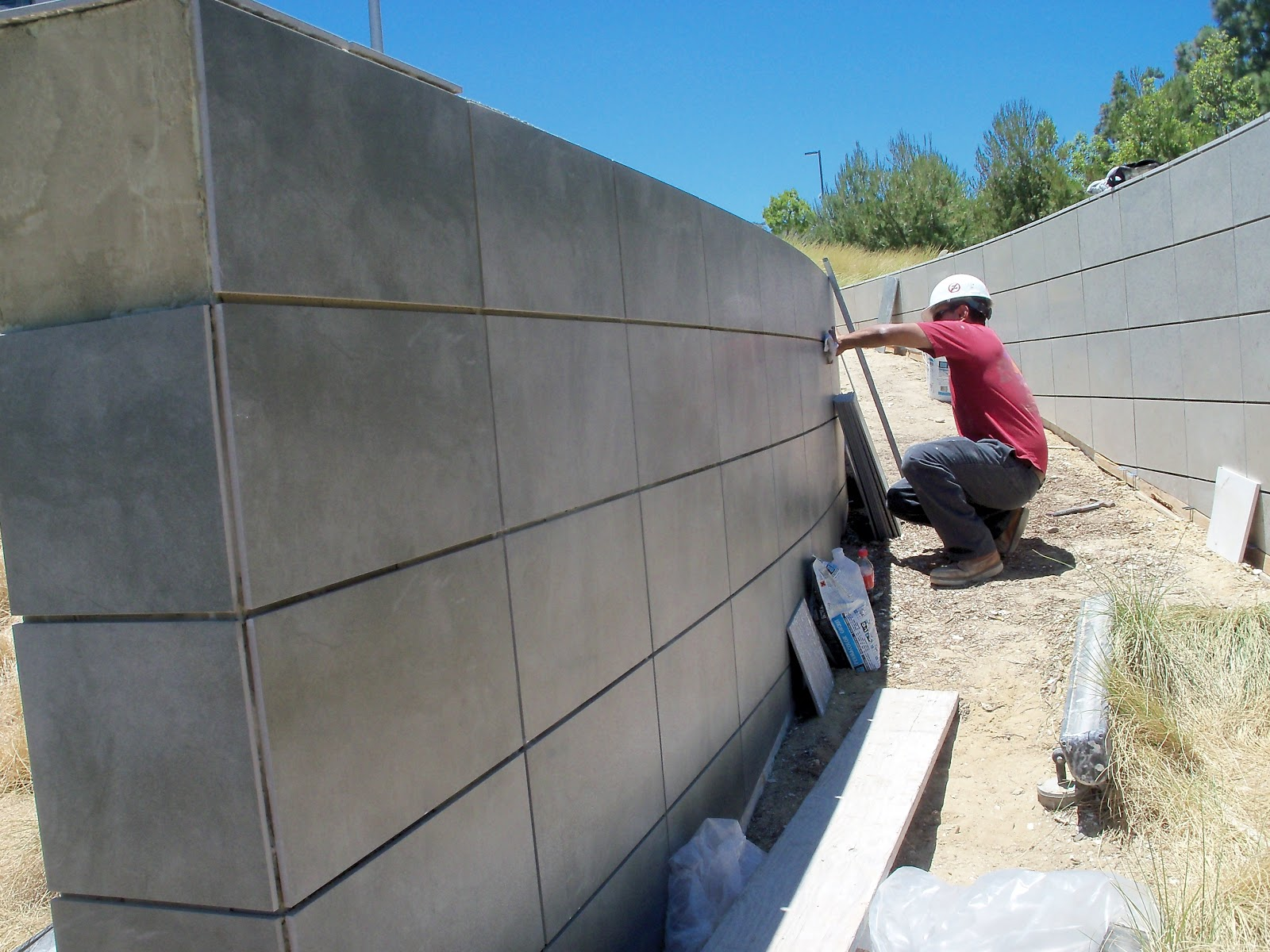 Man inspecting and installing tile and stone project as part of a contractual  service.