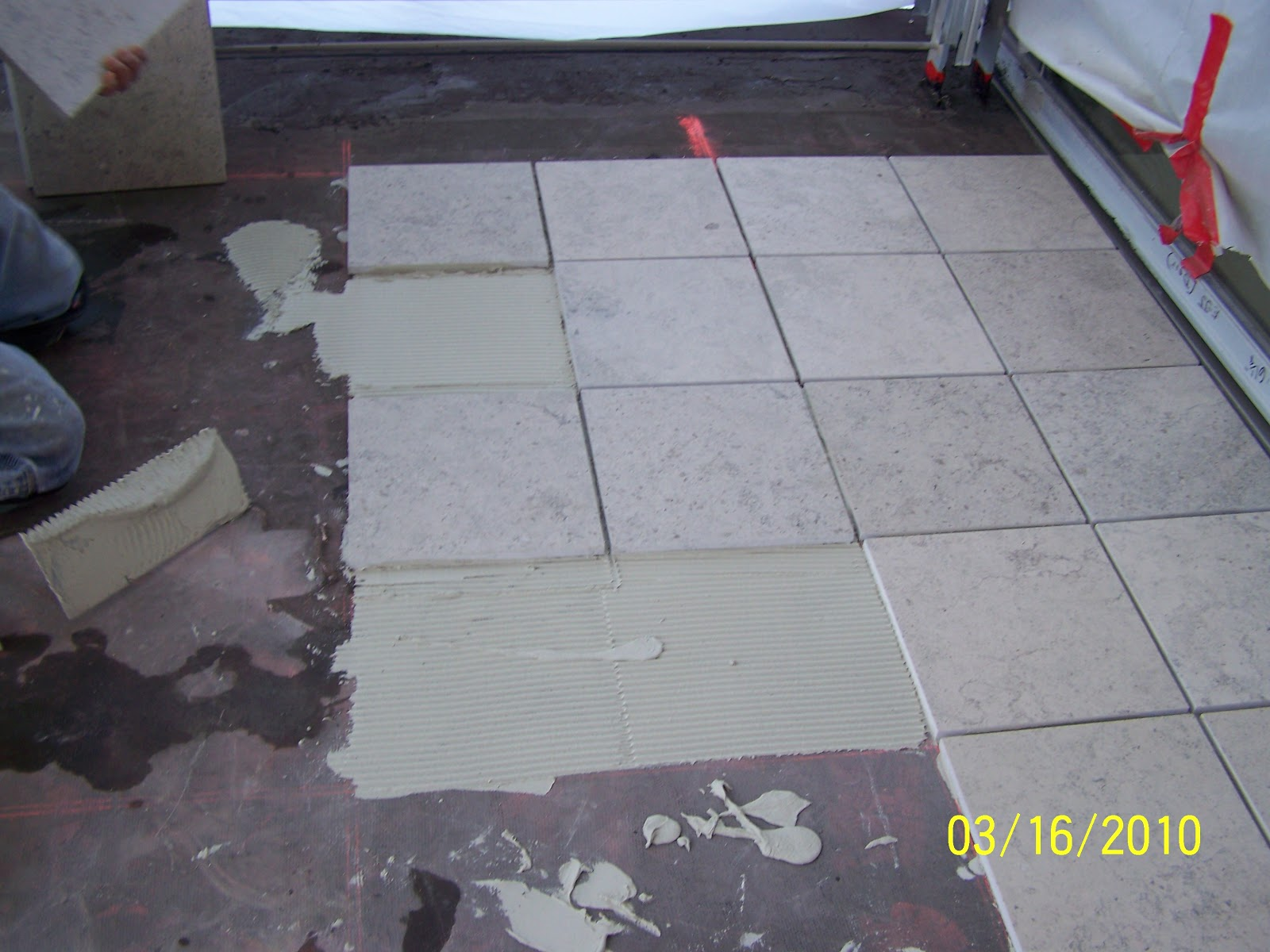 Tiles are carefully installed after conducting shear testing